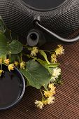picture of teapot  - teapot and cup with linden tea and flowers - JPG