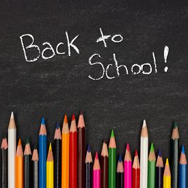 stock photo of pencils  - Bottom border of colorful pencil crayons against a blackboard with Back to School writing in chalk - JPG