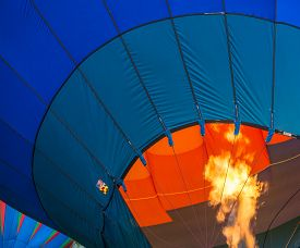 pic of nylons  - getting a hot air balloon ready to take off  by firing up a burner to heat the air  inside the nylon envelope - JPG