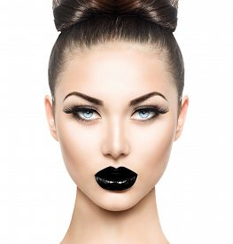 stock photo of gothic girl  - High Fashion Beauty Model Girl with Black Make up and Long Lushes - JPG