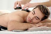 Man having massage in spa salon poster
