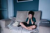 Scared Child Watching Scary Movie On Tv, Sitting On The Couch At Night poster