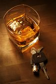 picture of sobriety  - Whiskey in light pool on brown table with car keys - JPG