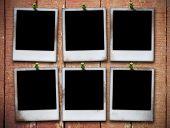 six photo frame on grunge wooden planks