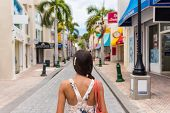 Постер, плакат: Woman tourist walking in shopping streets of Philipsburg St Maarten popular port of call for cruis