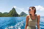 Happy woman cruising towards the deux gros pitons, popular tourist attraction in St Lucia. World Her poster