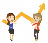 Two caucasain business women holding growth graph. Cheerful business team with growth graph. Concept poster