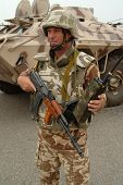 Romanian Soldier, Basra, Iraq With Aims Rifle.