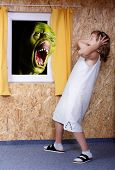 Screaming green zombie and fright little girl - green wooden head is unauthorized homemade work Great for Halloween brochures and advertisements