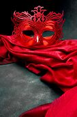 Decorated mask for masquerade on red velvet. Great for halloween brochures and advertisements. Unaut
