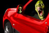 Horror scene. Monster face in red car.  Wooden sculpture - homemade unauthorized work. Great for Halloween brochures and advertisements