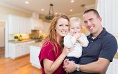Happy Young Military Family Inside Their Beautiful Kitchen. poster