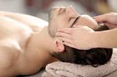 Man having face massage in spa salon poster