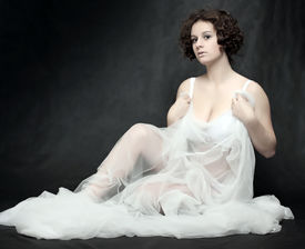 image of striper  - Beautiful slenderness young woman in bridal veil on black background - JPG