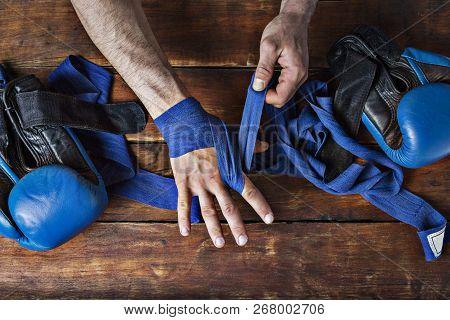 Man Bandage Boxing Tape On
