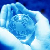 conceptual image of a globe in hand