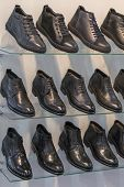 Mens Leather Shoes On The Shelf In The Store. Racks In The Store Of Clothes And Accessories. Shelves poster