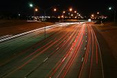 A Timed-Exposure Of An Interstate With Cars Wizzing By At Night