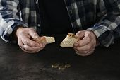 Poor Elderly Man With Bread At Table, Focus On Hands poster