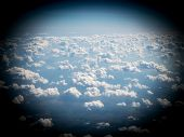 View Of Sky And Clouds From Airplane Porthole poster