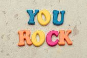 You Rock Compliment In Colorful Letters. Object. Close Up. Macro Photography poster