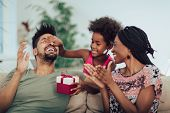Happy Black Family At Home. African American Father, Mother And Child Celebrating Birthday, Having F poster