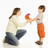Boy Giving Mother Flowers.