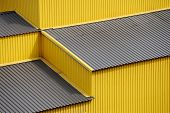 Yellow siding wall and roof as background