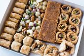 Variety Of Turkish Baklava In Box / Package. Assortment Of Traditional Dessert. poster