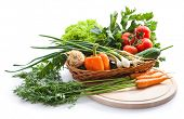 Organic vegetables in basket on white background