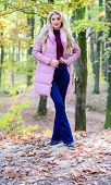 Girl Fashionable Blonde Walk In Park. Jackets Everyone Should Have. Best Puffer Coats To Buy. How To poster