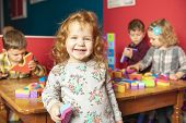 The Preschoolers Group In Kindergarten Together, Nursery Group Play With Block , poster