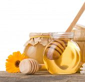 honey and flowers isolated on white background