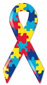 Satin awareness ribbon in brightly colored puzzle pattern, representing support of those with autism