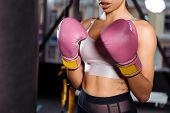 Partial View Of Strong Girl In Boxing Gloves Practicing Boxing In Gym poster