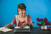 Smart And Trained. Senior Woman Type On Retro Typewriter. Journalist Work In Vintage Office. Senior  poster