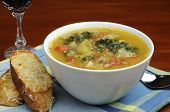 foto of vegetable soup  - Bowl of homemade vegetable soup with crusty bread - JPG
