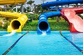 water slides in tropical aqua park poster