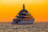 Luxury Yacht On Open Sea At Sunset