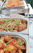 foto of chafing  - photograph of food on chafing dish at buffet
