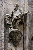 picture of castello brown  - a statue of a sint in the front of the milano - JPG