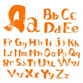handwritten by a textured brush alphabet with uppercase and lowercase characters