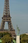 Statue Of Liberty Near The Eiffel Tower In Paris