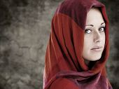 stock photo of muslim  - Young Arabic woman in wearing islamic scarf - JPG