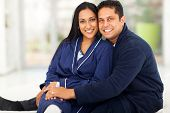 beautiful loving indian couple sitting in bedroom