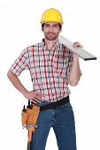 picture of shoulder-blade  - Craftsman with wood plank over his shoulder - JPG