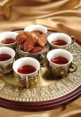 An arabic tea set with dates