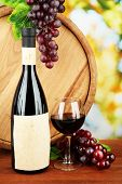 Composition of wine, wooden barrel and  grape, on bright background
