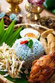 Traditional Malaysian food. Nasi kerabu is a type of nasi ulam, popular Malay rice dish. Blue color of rice resulting from the petals of  butterfly-pea flowers. Asian cuisine.