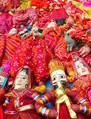 stock photo of rajasthani  - rajasthani puppet in red dress in dilli haat - JPG